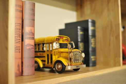 action blur bookcase books